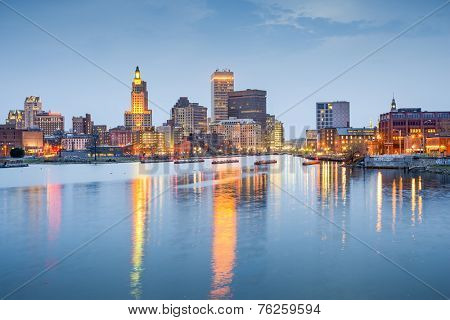 Providence, Rhode Island, USA city skyline on the Providence River at twilight.