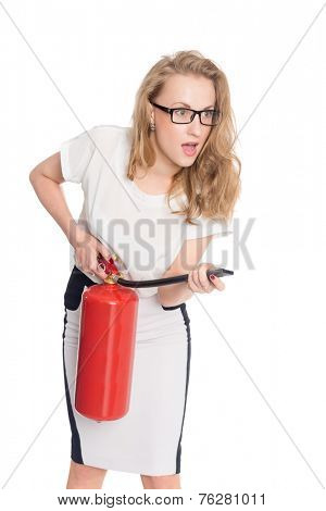 Young uptight woman with a fire extinguisher isolated on white