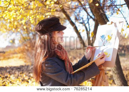The Girl Is Engaged In Painting