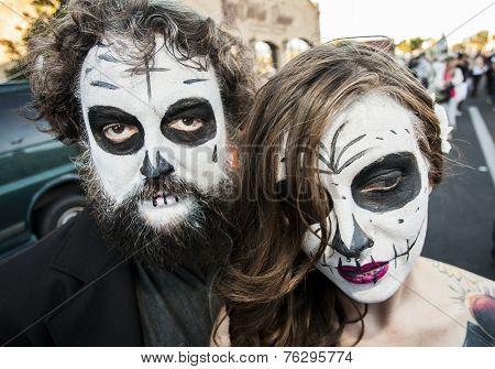 Couple In Dia De Los Muertos Face Paint
