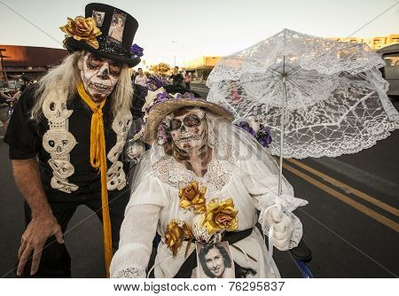 Senior Couple In Dia De Los Muertos Face Paint