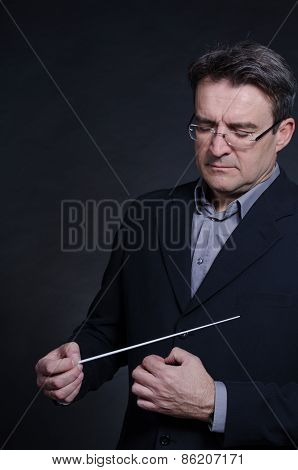 Portrait of a conductor using his baton poster
