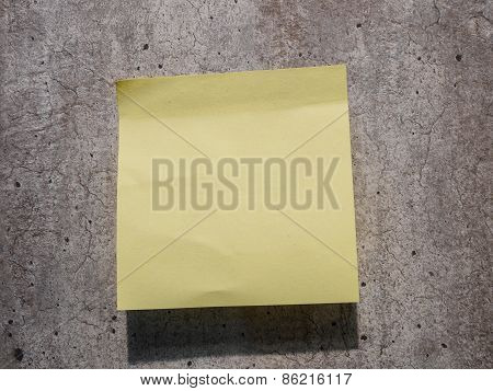 yellow reminder sticky note on wall
