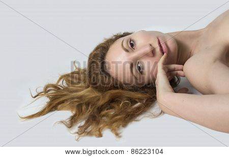 Woman lay down and her red hair spread