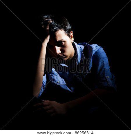 Portrait of depressed man on black background poster