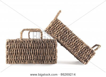 Two brown wicker baskets isolated
