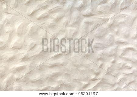 White beige plasterwork with bumpy surface