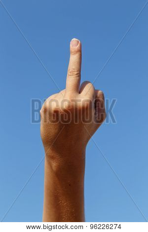 Middle Finger, Insult Sign With Sky At Background