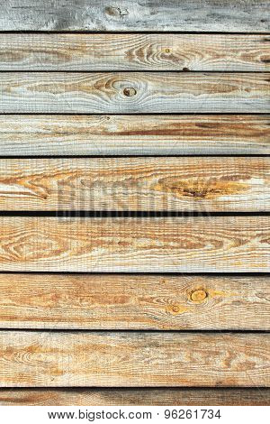 Wooden wall texture, gray unpainted wood background with knots and nails.