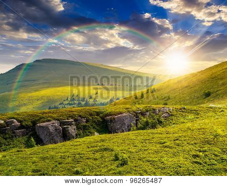 Mountain Peak Behind Hillside With Boulders At Sunset