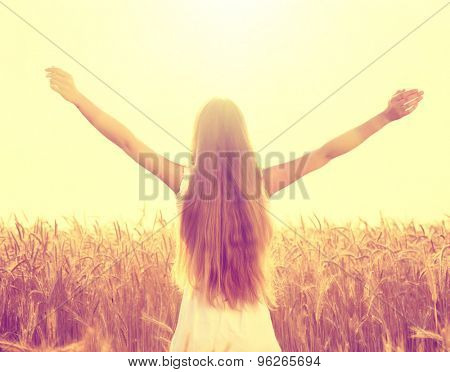 Autumn Girl enjoying nature on the field. Beauty Girl Outdoors raising hands in sunlight rays. Beautiful Teenage Model girl in white dress running on the Field, Sun Light. Glow Sun. Free Happy Woman