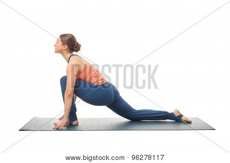 Beautiful sporty fit yogini woman practices yoga asana  Anjaneyasana - low crescent lunge pose in surya namaskar isolated on white