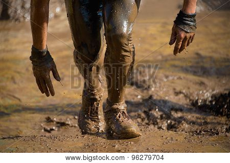 poster of Man Fighting To Get Through The Mud