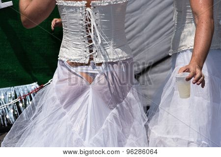 Munich, Germany - 11 July 2015: Christopher Street Day - A man in a torn bridal dress