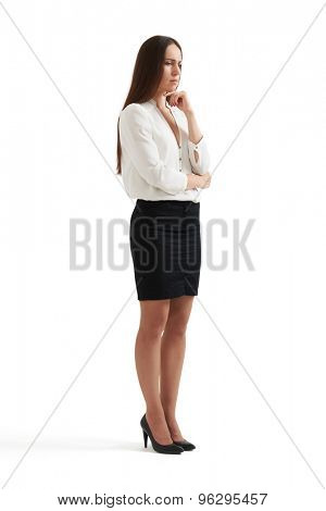 despondent businesswoman thinking about something and looking down. isolated on white background