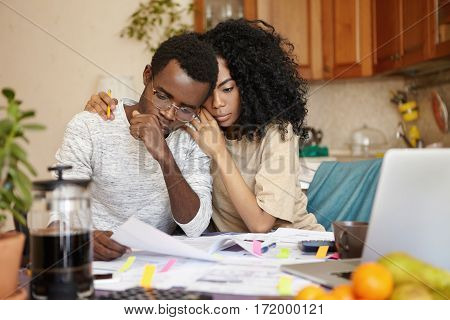 No Money. Depressed Desperate Bankrupt Young Dark-skinned Family Feeling Financial Stress While Read