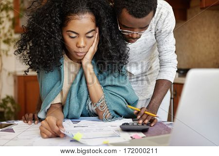 People, Family Budget, Finances And Payments Concept. African-american Man Wearing Glasses Helping H