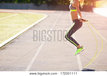 Close Up Of Woman Feet Jumping, Using Skipping Rope In Stadium
