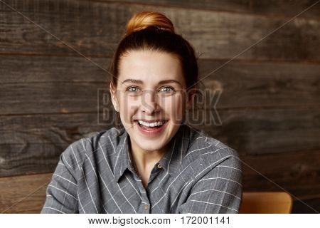 Omg! Beautiful Young Female With Hair Bun Having Joyful Look, Smiling Cheerfully, Happy With Some Po