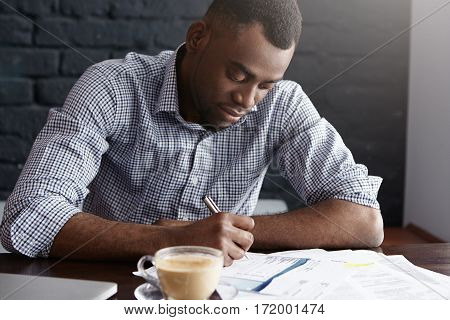 Candid Shot Of Handsome Confident Young African Businessman Drinking Coffee At Restaurant, Working O