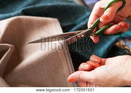 Tailor. Hands Notch Tailor Tailor's Scissors Cloth. Close Up.