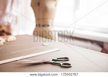 Still Life Photo Of A Suit Pattern Template With Tape Measure, Chalk And Scissors. Sewing Tools And
