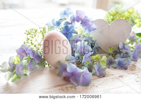 Tender easter motif with flowers and a heart for a greeting card