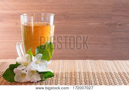 Apple juice in a glass on a wooden background.  Free space for creativity.