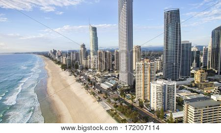 Aerial view looking down to Gold Coast Surfers Paradise cityscape and famous beach.