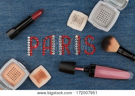 Paris. The world capitals of fashion. Word inlaid rhinestones and cosmetics. View from above