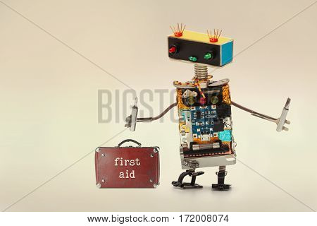 First Aid Kit And Handyman Service Worker With Screwdrivers. Fun Toy Robot, Colorful Head Red Blue L