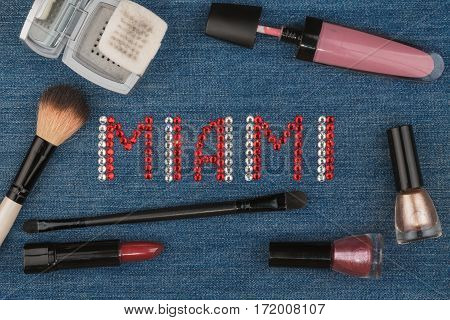 Miami. World capitals of fashion. Word inlaid rhinestones and cosmetics. View from above