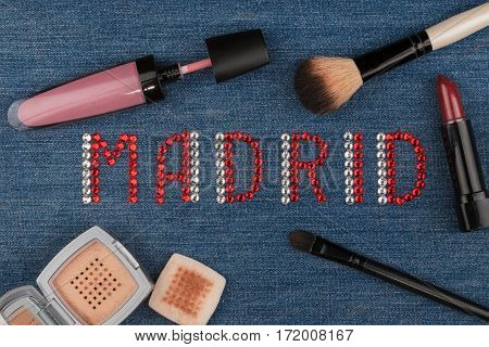Madrid. World capitals of fashion. Word inlaid rhinestones and cosmetics. View from above