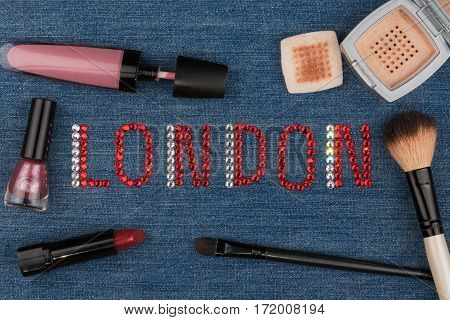 London. World capitals of fashion. Word inlaid rhinestones and cosmetics. View from above