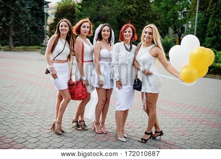 Five Girls With Balloons At Hand On Hen Party.