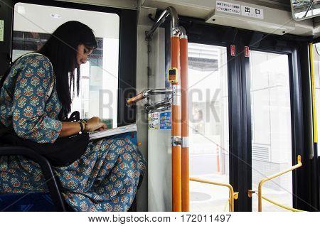 Traveler Thai Woman Sit On Bus At Saitama City Go To Kawagoe Or Kawagoe Little Edo