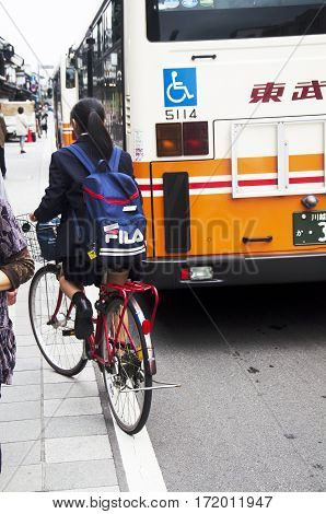 Japanese Student Girl Riding Bicycle Go Back Home After Finished Class On The Road At Kawagoe  In Sa