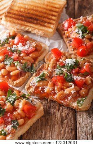 Delicious Toast With White Beans, Tomatoes, Cheese And Herbs Closeup. Vertical