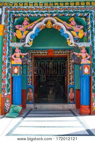 HIMALAYAS, INDIA. 9 Jun 2009: The colorful entrance to an ancient Hindu Temple in Mandi, India.