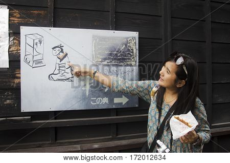 Thai Woman Hold Snack Japanese Style And Look Information Board Of Show At Kawagoe Town Is Also Know