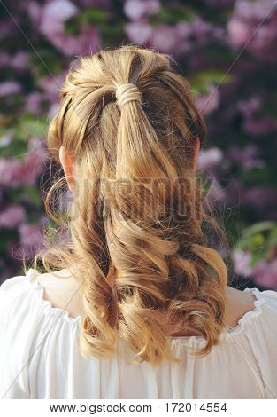 blond girl with curly hairstyle