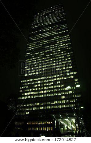 Japanese people working in tower building at night time at Shinjuku city of Kanto region in Tokyo Japan