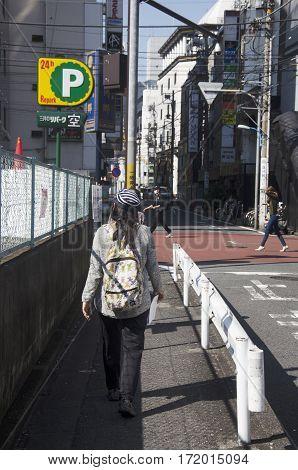 Traveler Thai Woman Walking On Street In Small Alley Go To Subway Station At Shinjuku