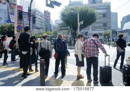 Japanese People Waiting Traffic Signs For Walk Crossover Traffic Road With Cityscape At Shinjuku