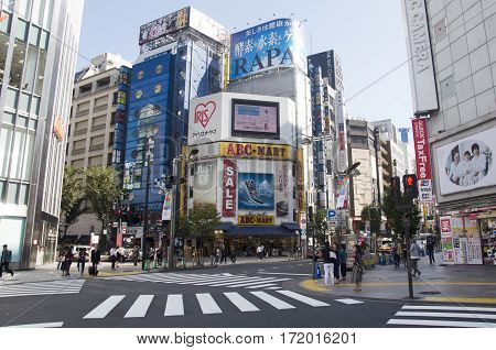 Japanese People And Foreigner Travelers Walking Crosswalk Traffic Road At Shinjuku