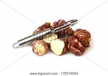 White background with knife and sweet potato, Jerusalem, pictures