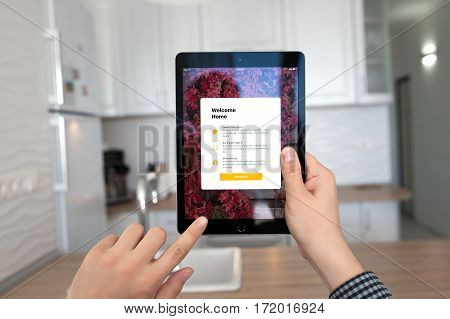 Alushta Russia - October 29 2016: Man hands holding iPad Pro Space Gray with app Home in the screen. iPad Pro 9.7 was created and developed by the Apple inc.