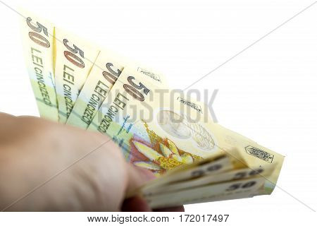 Man hand holding Romanian money isolated over white background with clipping path