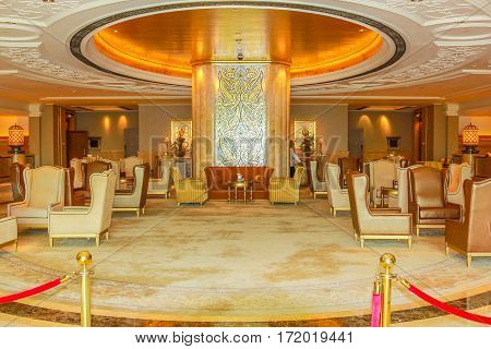 Abu Dhabi, United Arab Emirates - April 21, 2013: monumental main entrance in luxurious hotel and landmark Emirates Palace. Decorations inside with gold, marble and Swarovski. Luxury travel concept.