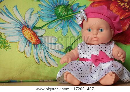 baby doll sitting on a flower background